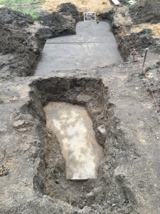 The early 1900s sidewalk, partially uncovered.