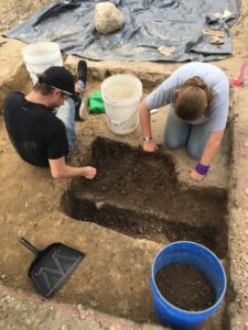 Josh and Kaleigh excavate the Unit A feature.