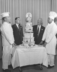 Bakers along side MSU centennial cake. Image source: MSU Archives
