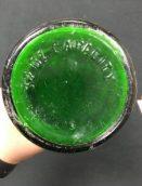 """""""32 OZ Capacity"""" embossed on bottle of bottle."""