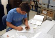 Jeff Painter records a ceramic sherd.