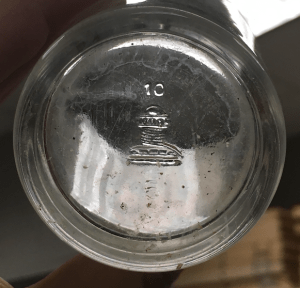 Bottom of tumbler showing Capstan makers mark and date stamp.