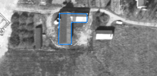Screenshot of historical aerial photography overlain with measurement tool, depicting process laid out in step 5.