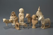 Ceramic figures found in a box on top of the coffin of a one-year-old Roman child