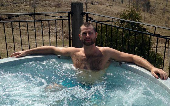 Arlie enjoys the hot tub at Big Brother Canada Jury House