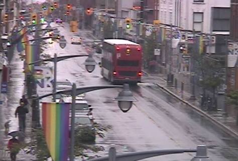 Going to be a very rainy two days in Ottawa - Bank Street at the intersection of Lisgar Street