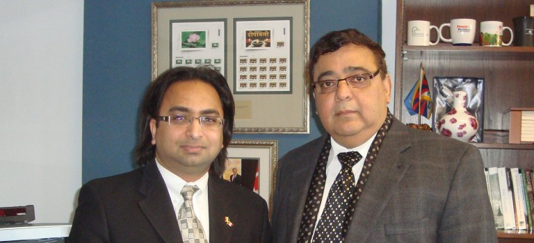 Husain (L) with Hon. Deepak Obhrai, Parliamentary Secretary to the Minister of Foreign Affairs