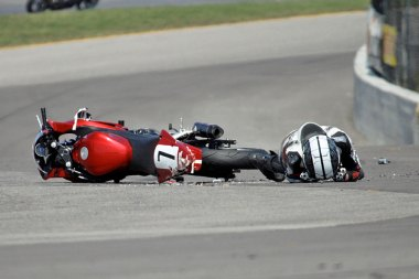 Smith lies next to Costa's bike after been hit by two riders.