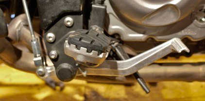 On-road/off-road footpegs have a slight forward tilt but the rubber is removable to reveal off-road serrated pegs.