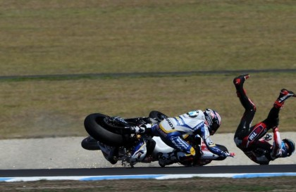 Marco Melandri - seen here involved in a crash with Ducati's Carlos Checa (R) - managed a third-place finish for BMW in the weekend's second race.