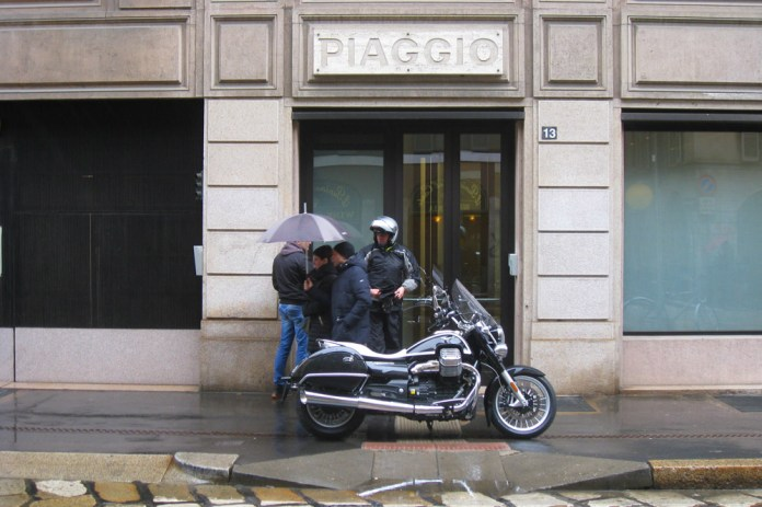 Once the bike arrived, so did the rain, Ready for the ride outside Piaggio HQ in Milan. Photo: Daniele Toressan