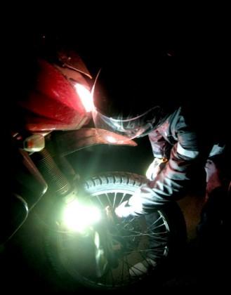 Stopping to fix Jim's dangling Denali light