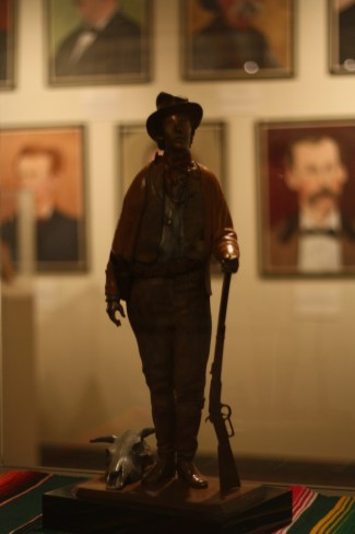 A statue of Billy the Kid from a museum in Lincoln. The portraits on the wall behind are all paintings of the key players in the Lincoln County War. You'll never see a bigger collecton of rascals and cuthroats in your life. Photo: Zac Kurylyk