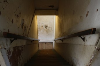 Supposedly, there's a bullet hole in the wall at the bottom of these stairs in Lincoln's old courthouse, left by Billy the Kid during his desperate getaway. Photo: Zac Kurylyk
