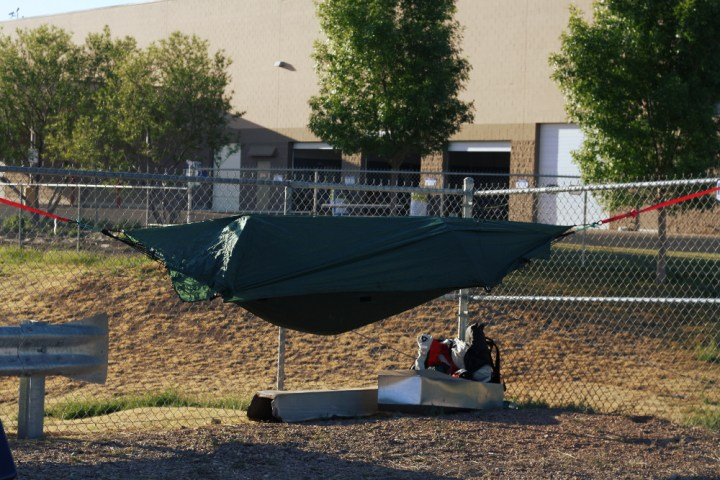 My first night camping at Wal-Mart. My strategic location allowed me to hang in the corner of a chain link fence, and also get free wi-fi access from Sam's Club. No aliens tried to abduct me, illegal or otherwise.