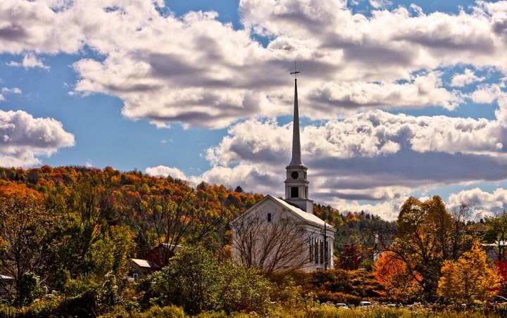 Fall foliage in Stowe, Vermont. This is what you get when you tour in New England. Photo: Patrick/Wikimedia