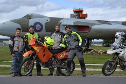 Terry, Peter and Oliver get a tour around Goose Bay from local ADVrider Jimmy. Photo: Big Land Adventure Films