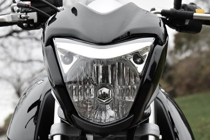 The headlight follows modern naked bike styling; gone are the days of simple round or square lights.