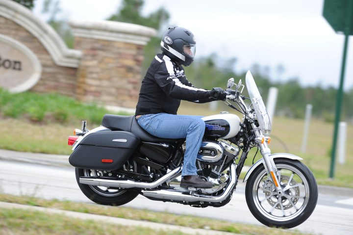 The slammed look might work visually, and appeal to shorter riders, but lowering the Sportster hurts its handling.
