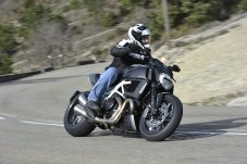 Costa didn't feel like the Diavel's weight and stance held his riding back much.