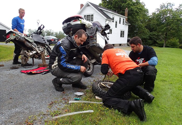 Here's a tip for the road: If you're going to get a flat tire, try to get it while you're riding with a Swiss adventure biker, who just happens to have a complete tire-changing toolkit aboard his bike. Photo: Rob Harris