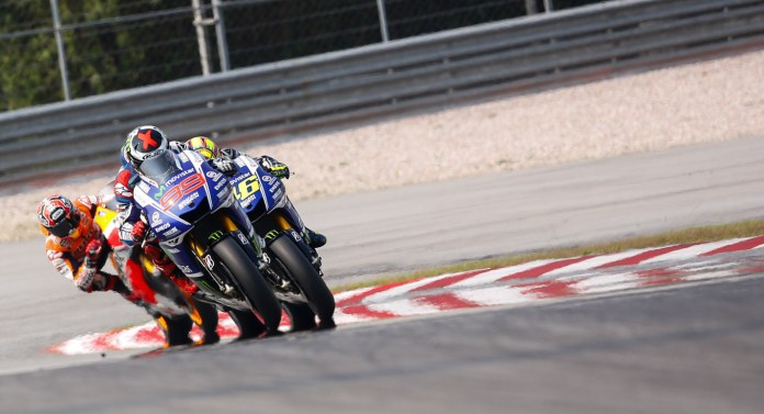 Lorenzo leads Rossi and Marquez; at race's end, Marquez and Lorenzo had switched spots.