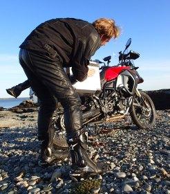 Micael Uhlarik polishes the saddlebag for a photo shoot during our spring tour.