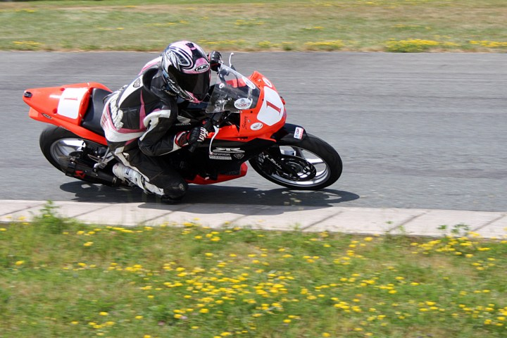 Stacey Nesbitt carves up the competition in the Honda CBR250 cup