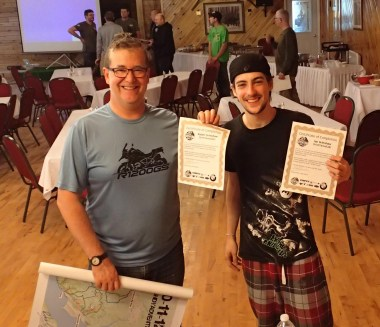 Father and son team, the Grimshaws collect their certificates of completion at the end of the rally