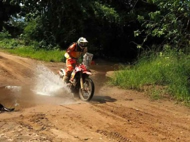 Trahan blasts through the jungle on his 250.