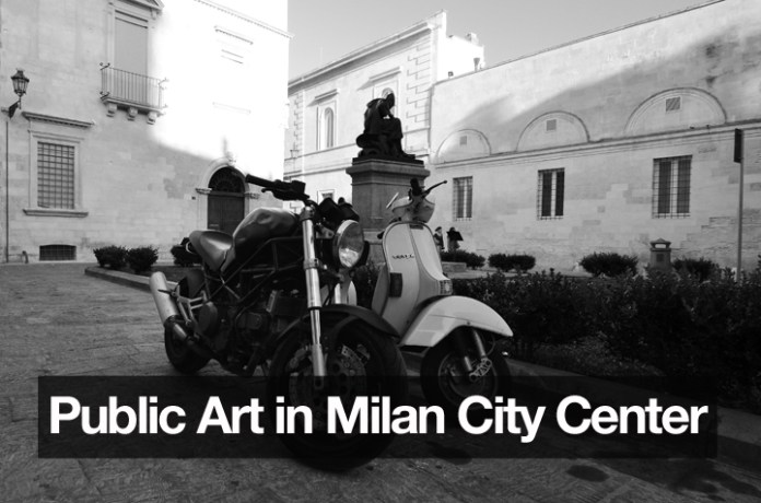 Early model Ducati Monster and Vespa PX flirt with each other in the piazza. Photo : Endre Sebok