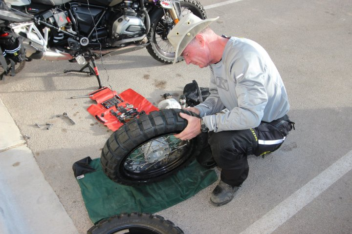 If you're headed further from home, you need the capability to repair your driveline and tires. Here, Bill Dragoo pulls off a tire change in a motel parking lot. Photo: Bill Dragoo
