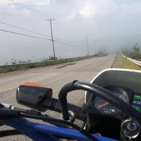 Fog closes in on the causeway in Lepreau. The mist is ever-present on spring and early summer rides, depending on wind direction.