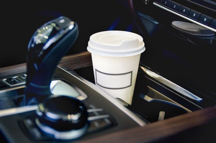 cup of coffee in vehicle's cup holder