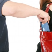 Pickpocket steals wallet from purse