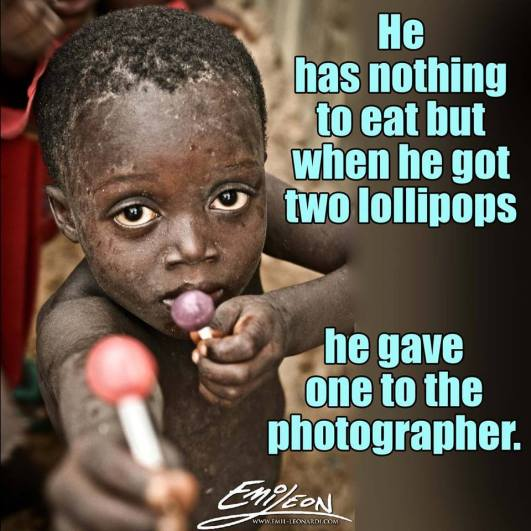 poor child offering photographer a lolipop