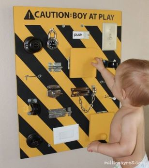 busy board caution boy at play