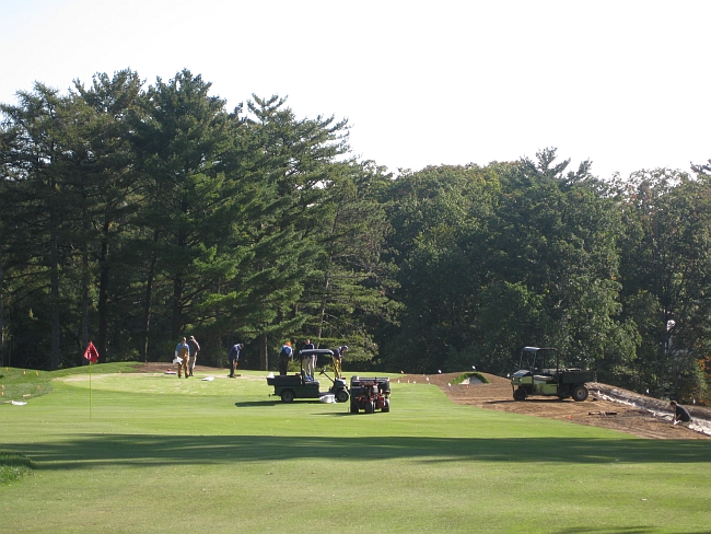 Prepping for the open -- work on the 17th hole.