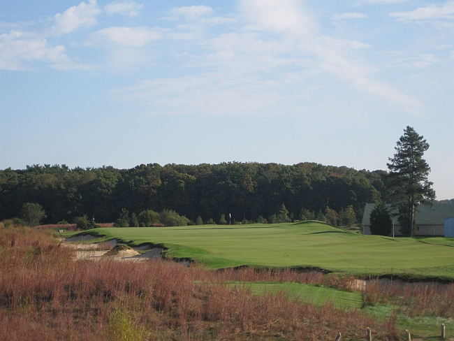 The fourth hole, a par-3, minus a tree that used to reside behind the green.
