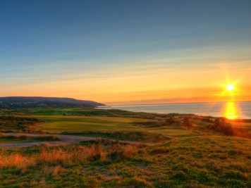 Sun sets over the long par-5 2nd hole at Cabot Links
