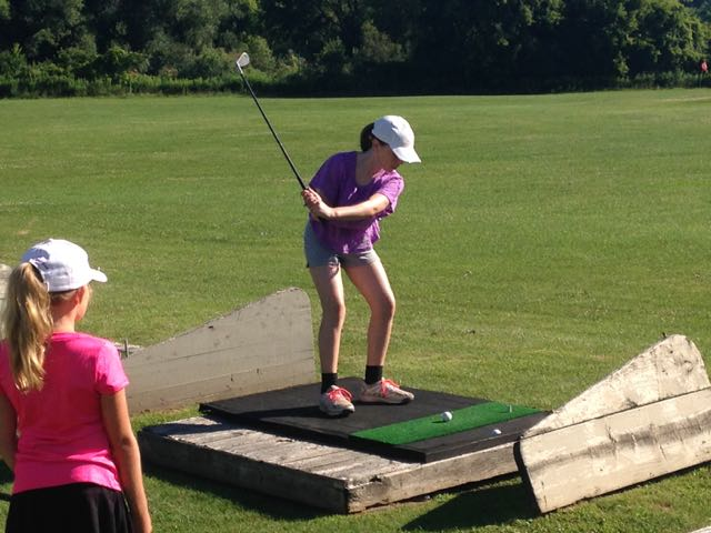Syd works on her swing during her second day at TGA.