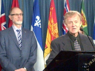 Alex Atamanenko and Dr. Ray Kellosalmi at the podium