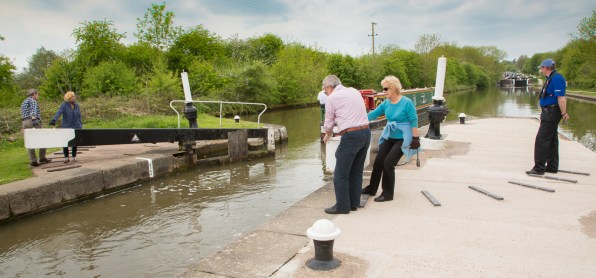 Italians and volunteer lock keeper at Lock 36.