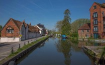 View west from Water mills Swing Bridge with Weavers' Cottages on the left.