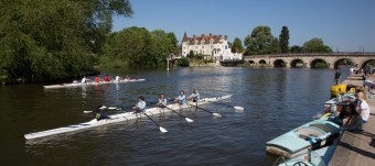 Schoolgirls' regatta at Maidenhead with Maidenhead Bridge and the Riviera Hotel beyond.