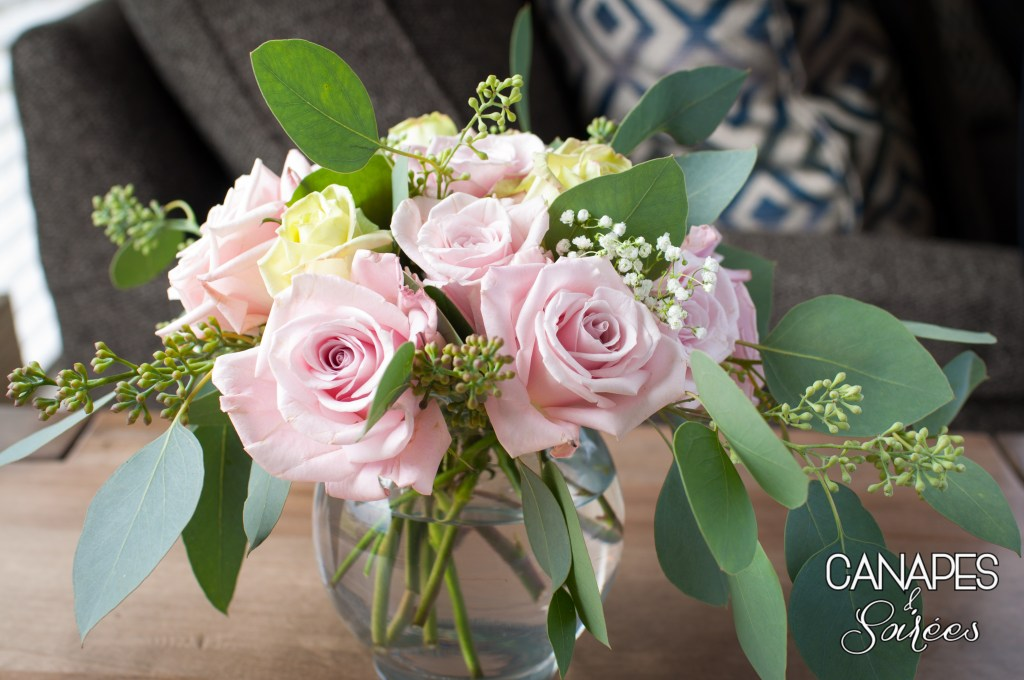 Full view of pink rose and seeded eucalyptus floral arrangement