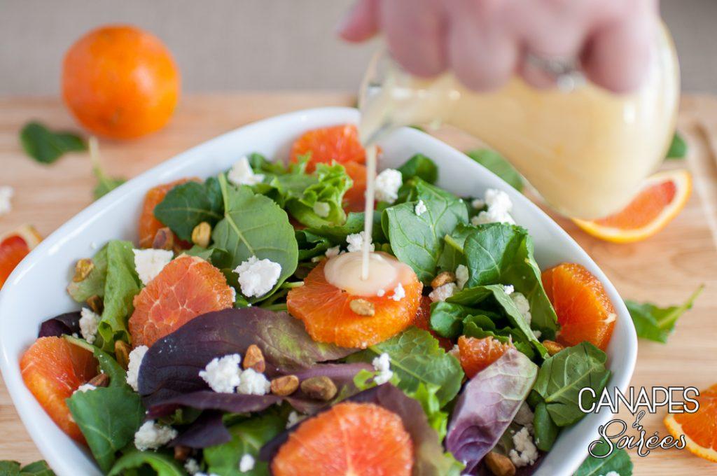 Vinaigrette being poured on Cara Cara Orange Salad