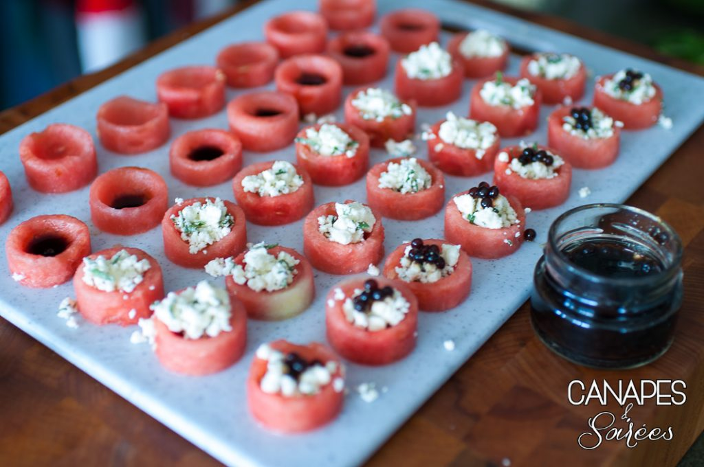 Assembling watermelon feta balsamic canapes