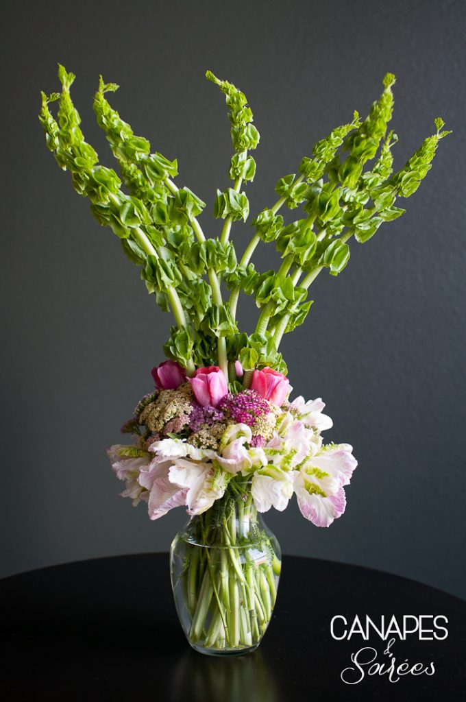 Bells of Ireland, Texas wildflowers and spring tulips come together in this beautiful tall spring floral arrangement.