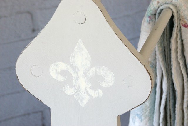 Thrift store blanket rack makeover.  Painted with chalk paint and a fleur de lis.  https://canarystreetcrafts.com/.